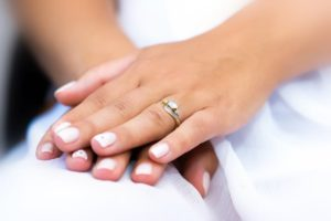 Wedding ring with stone on bride hand