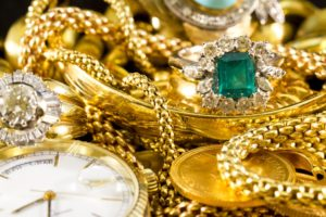 Gold Buyer: Closeup of gold jewelery with precious stones, twerys